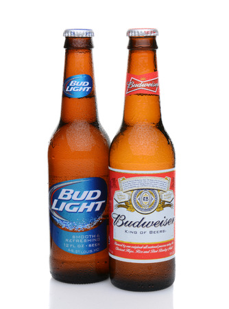 budweiser: IRVINE, CA - MAY 27, 2014: A bottle of Budweiser and Bud Light with condensation. From Anheuser-Busch InBev, Budweiser and Bud Light are top selling domestic beers in the United States.