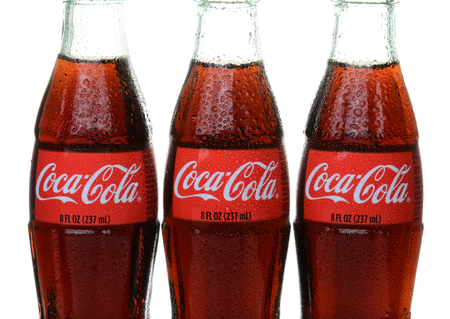 IRVINE, CA – February 10, 2014: Closeup of three bottles of Coca-Cola with condensation. Coke is one of the most popular soft drinks in the world.