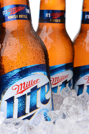 lite: IRVINE, CA - MAY 30, 2014: Closeup of Miller Light beer bottles in ice. Introduced in 1975 Miller Lite was one of the first Reduced Calorie beers to be successful in the American marketplace.