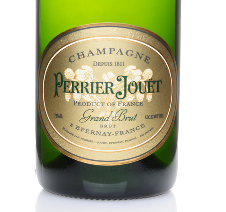 champagne region: IRVINE, CA – February 10, 2014: A bottle of Perrier Jouet Champagne. Founded in 1811 they are based in the Epernay region of Champagne, France