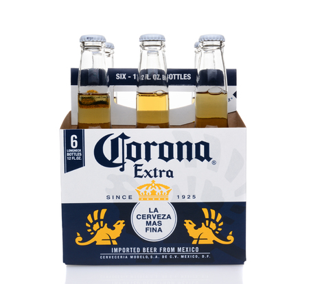 6 pack: IRVINE, CA - MAY 25, 2014: A 6 pack of Corona Extra Beer, side view. Corona is the most popular imported beer in the United States.