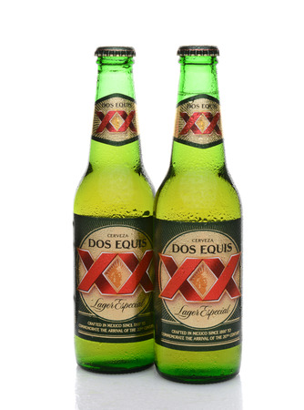 especial: IRVINE, CA - MAY 25, 2014: Two Bottles of Dos Equis Lager Especial with condensation. Founded in 1890 from the Cuauhtemoc-Moctezuma Brewery in Monterrey, Mexico a subsidary of Heineken International.
