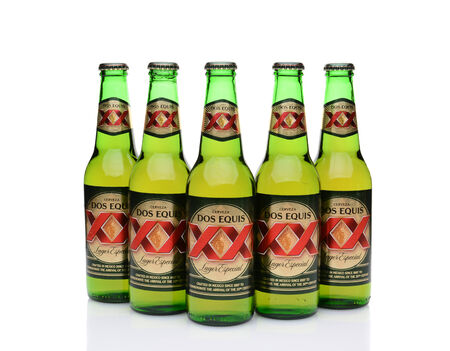 especial: IRVINE, CA - MAY 27, 2014: Five Bottles of Dos Equis Lager Especial on white with reflection. Founded in 1890 from the Cuauhtemoc-Moctezuma Brewery in Monterrey, Mexico a subsidiary of Heineken International.