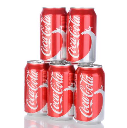IRVINE, CA - January 05, 2014: Photo of 5, 12 ounce cans of Coca-Cola Classic, with wave and surfer design. Coca-Cola is the one of the worlds favorite carbonated beverages.