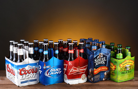 IRVINE, CA - MAY 25, 2014: Five 6 packs of Domestic Beers. Five of the most popular Imported beer brands: Coors Light, Bud Light, Budweiser, Samuel Adams and Sierra Nevada on wood table. Editorial
