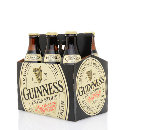six pack: IRVINE, CA - MAY 25, 2014: A 6 pack of Guinness Extra Stout. Guinness is one of the worlds most successful beer brands with annual sales over 850 million liters.