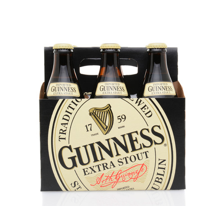 6 pack beer: IRVINE, CA - MAY 25, 2014: A 6 pack of Guinness Extra Stout. The Irish beer is one of the worlds most successful beer brands with annual sales over 850 million liters.