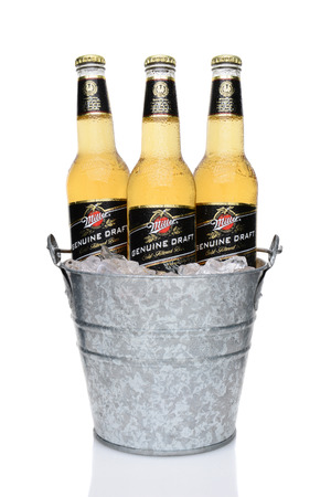 miller: IRVINE, CA - MAY 27, 2014: Miller Genuine Draft bottles in a bucket of ice. MGD is actually made from the same recipe as Miller High Life except it is cold filtered. Editorial