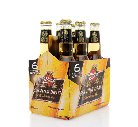 6 pack beer: IRVINE, CA - MAY 25, 2014: A 6 pack of Miller Genuine Draft, side view. MGD is actually made from the same recipe as Miller High Life except it is cold filtered. Editorial