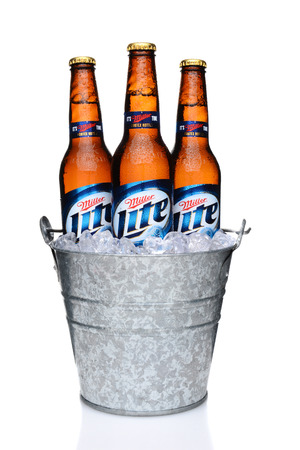 IRVINE, CA - MAY 27, 2014: Miller Light bottles in a bucket of ice. Introduced in 1975 Miller Lite was one of the first Reduced Calorie beers to be successful in the American marketplace.