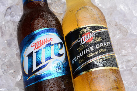 lite: IRVINE, CA - MAY 27, 2014: A bottle of MGD and Miller Lite on a bed of ice. Miller Genuine Draft and Miller Lite are two popular domestic beers in the United States. Editorial