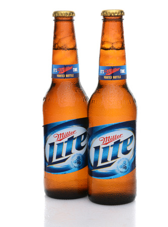 IRVINE, CA - MAY 27, 2014: Two bottles of Miller Light with condensation. Introduced in 1975 Miller Lite was one of the first Reduced Calorie beers to be successful in the American marketplace. Editorial