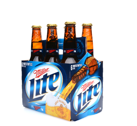6 pack beer: IRVINE, CA - MAY 25, 2014: A 6 pack of Miller Light beer, 34 view. Produced by MillerCoors, Miller Lite was introduced in 1975 and quickly became the number two brand in America.
