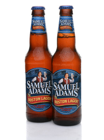 adams: IRVINE, CA - MAY 25, 2014: Two bottles of Samuel Adams Boston Lager with condensation. Brewed by the Boston Beer Company one of the largest American-owned beermakers.