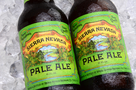IRVINE, CA - MAY 25, 2014: Two bottles of Sierra Nevada Pale Ale on ice. Sierra Nevada Brewing Co. was established in 1980 by homebrewers in Chico, California.