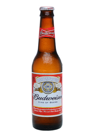 domestic: IRVINE, CA - MAY 27, 2014: A single bottle of Budweiser on white with condensation. From Anheuser-Busch InBev, Budweiser is one of the top selling domestic beers in the United States. Editorial