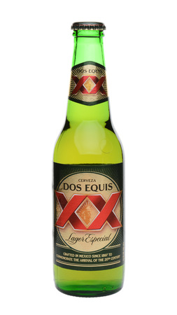 especial: IRVINE, CA - MAY 27, 2014: A single Bottle of Dos Equis Lager Especial on white. Founded in 1890 from the Cuauhtemoc-Moctezuma Brewery in Monterrey, Mexico a subsidiary of Heineken International.