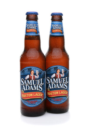 samuel: IRVINE, CA - MAY 25, 2014: Two bottles of Samuel Adams Boston Lager with condensation. Brewed by the Boston Beer Company one of the largest American-owned beermakers.