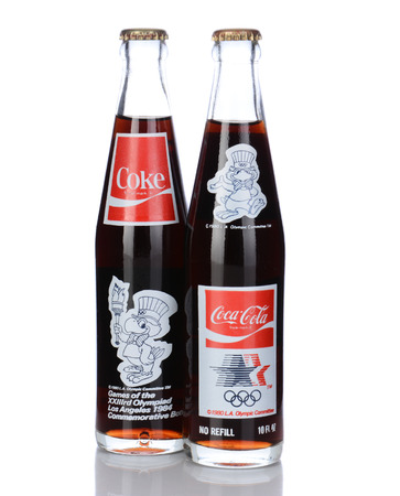 IRVINE, CA - January 05, 2014: 2 Commemorative Bottles of Coca Cola from the 1984 Los Angeles Olympic Games. The front and back of the bottles are shown with the mascot and logo.