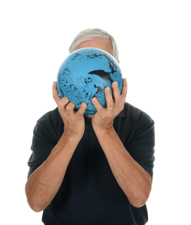 bowling ball: Closeup of a middle aged man preparing to bowl. He is holding the ball in front of his face making him unrecognizable. Vertical format over white.