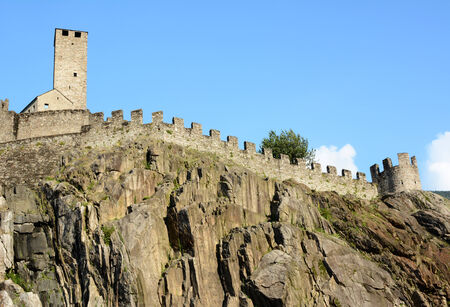 ramparts: BELLINZONA, SWITZERLAND - July 4, 2014: The Torre Bianca (White tower) and ramparts of the Castelgrande in Bellinzona, Switzerland. A UNESCO World Heritage Site, seen from below.