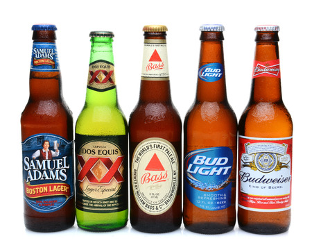 samuel: IRVINE, CALIFORNIA - JULY 14, 2014: 5 bottles of assorted cold beers. Domestic and Imported brews including, Budweiser, Bud Light, Bass, Dos Equis and Samuel Adams.