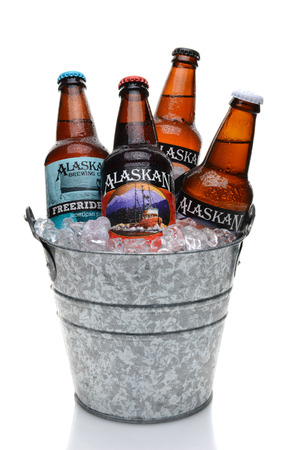 microbrewery: IRVINE, CALIFORNIA - JULY 16, 2014: Ice Bucket full of Alaskan Brewing Co. beers. Alaskan Brewing, founded in 1986 in Juneau, Alaska, was the first Juneau brewery since prohibition.