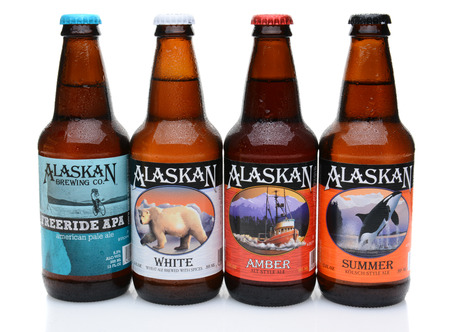 microbrewery: IRVINE, CALIFORNIA - JULY 16, 2014: Four bottles of Alaskan Brewing Co. beers. Alaskan Brewing, founded in 1986 in Juneau, Alaska, was the first Juneau brewery since prohibition.