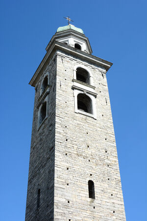 cattedrale: LUGANO, SWITZERLAND - JULY 6, 2014: Bell Tower of The Cathedral of Saint Lawrence. The tower is in the Baroque style with an octagonal lantern covered by a cupola, designed by Costante Tencalla.