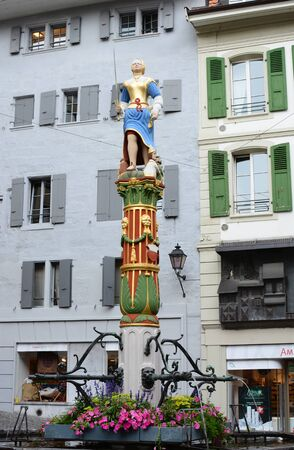 fontaine: LAUSANNE, SWITZERLAND - JULY 7, 2014: The Fountain of Justice (Fontaine de la Justice). The fountain dates from 1557, and the original statue, made in 1585, was replaced by a copy in 1930.