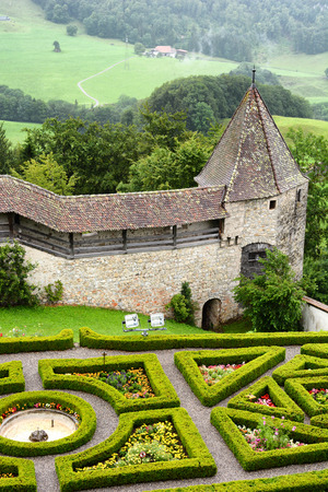 ramparts: GRUYERES, SWITZERLAND - JULY 8, 2014: Garden and ramparts at Gruyeres Castle. Located in the medieval town of Gruyeres and built between 1270 & 1282, it is one of the most famous castles in Switzerland.