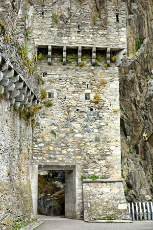 ramparts: BELLINZONA, SWITZERLAND - JULY 4, 2014  The entrance to Castelgrande, Bellinzona  The portal with access from the Piazza del Sole leads to an elevator and stairs to take you to the top of the ramparts