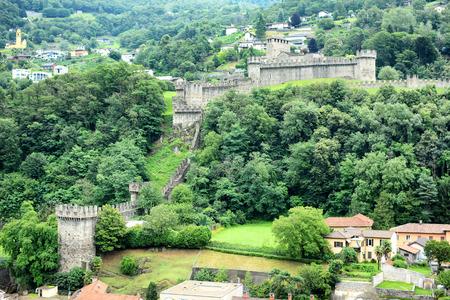 ramparts: BELLINZONA, SWITZERLAND - JULY 4, 2014  Castello di Montebello seen from Castelgrande  Montebello is the name of the hill on which the castle stands