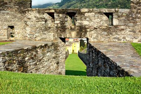 ramparts: BELLINZONA, SWITZERLAND - JULY 4, 2014  Lawn and Ramparts at Castelgrande, Bellinzona  A UNESCO World Heritage Site, the fortress overlooks the town of Bellinzona providing dramatic vistas
