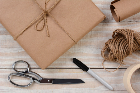 high angle shot: High angle shot of the tools and materials for wrapping a parcel.
