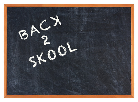 backwards: Misspelled words Back 2 Skool on a chalkboard, Some letters are written backwards.  Stock Photo