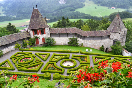 ramparts: GRUYERES, SWITZERLAND - JULY 7, 2014: Gardens and Ramparts at Gruyeres Castle. One of the most famous castles in Switzerland was built between 1270 & 1282.