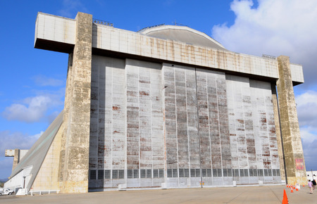 orange county: TUSTIN, CALIFORNIA - MAY 15, 2013: Blimp Hangar 1 at the former MCAS, Tustin, CA. Closeup of the massive doors of the wooden hangar to be preserved and the centerpiece of a new Regional Park.