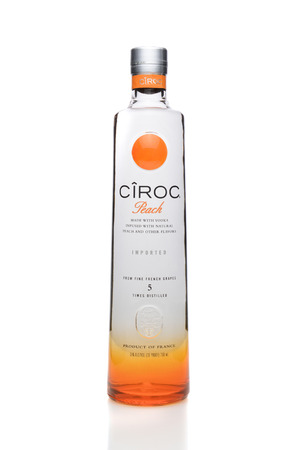 distilled: IRVINE, CA - SEPTEMBER 08, 2014: A bottle of Ciroc Peach Vodka. An ultra-premium vodka distilled from grapes grown in the Cognac region of France infused with natural flavors.