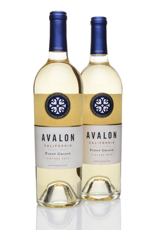 pinot grigio: IRVINE, CA - JUNE 23, 2014: Two bottles of Avalon Pinot Grigio Wine. From the Purple Wine Company in Graton, California, Avalon sources its grapes from premiere vineyards in the state. Editorial