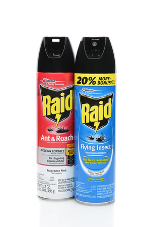 raid: IRVINE, CA - SEPTEMBER 08, 2014: Two cans of Raid Insecticide. Raid is the brand name of a line of insecticide products produced by S. C. Johnson & Son, first launched in 1956.