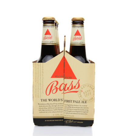 6 pack beer: IRVINE, CA - MAY 25, 2014: A 6 pack of Bass Ale, end view. The Bass Brewery was founded in 1777 by William Bass, in Trent, England is now owned by Anheuser-Busch InBev.