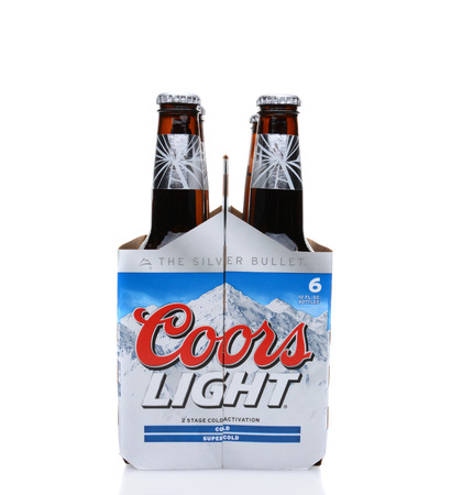 6 pack beer: IRVINE, CA - MAY 25, 2014: A 6 pack of Coors Light Beer end view. Coors operates a brewery in Golden, Colorado, that is the largest single brewery facility in the world.