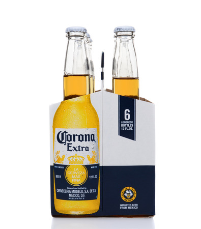 6 pack beer: IRVINE, CA - MAY 25, 2014: A 6 pack of Corona Extra Beer, end view. Corona is the most popular imported beer in the United States.