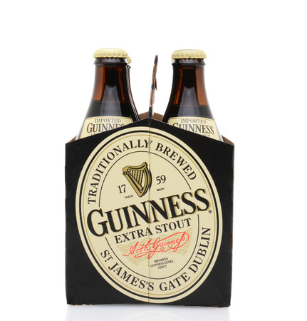 IRVINE, CA - MAY 25, 2014: A 6 pack of Guinness Extra Stout, end view. The Irish beer is one of the worlds most successful beer brands with annual sales over 850 million liters.