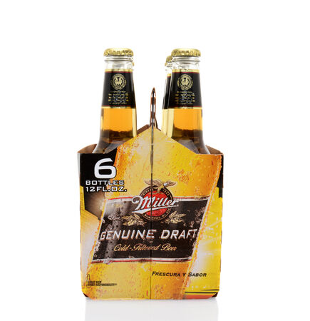 6 pack beer: IRVINE, CA - MAY 25, 2014: A 6 pack of Miller Genuine Draft, end view.  MGD is actually made from the same recipe as Miller High Life except it is cold filtered.