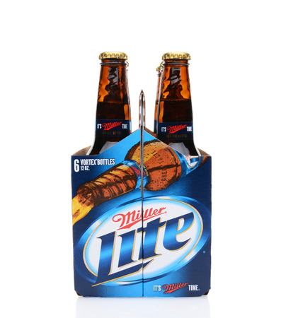 6 pack beer: IRVINE, CA - MAY 25, 2014: A 6 pack of Miller Light beer, end view. Produced by MillerCoors Miller Lite was introduced in 1975 and quickly became the number two brand in America.