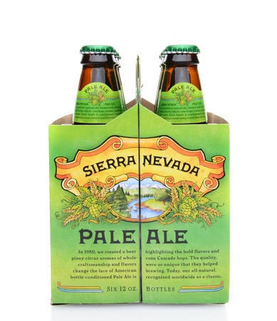 6 pack beer: IRVINE, CA - MAY 25, 2014: An end view of a 6 pack of Sierra Nevada Pale Ale. Sierra Nevada Brewing Co. was established in 1980 by homebrewers in Chico, California,