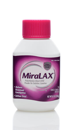 IRVINE, CA - JUNE 23, 2014: A 8 ounce bottle of MiraLax laxative. MiraLax is a polyethylene glycol powder for the treatment of occasional constipation manufactured by Merck & Co.  Editorial
