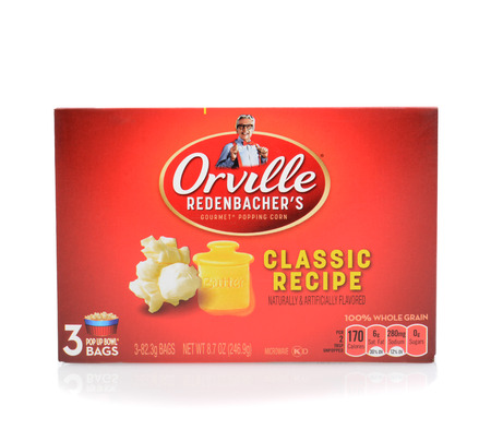 likeness: IRVINE, CA - JUNE 23, 2014: A box of Orville Redenbacher Microwave Popcorn. The brand launched in 1970 features the likeness of founder and spokesman Orville Clarence Redenbacher.